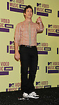 LOS ANGELES, CA - SEPTEMBER 06: Andy Samberg poses in the press room during the 2012 MTV Video Music Awards at Staples Center on September 6, 2012 in Los Angeles, California.