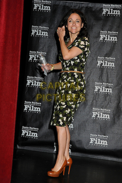 "Julia Louis-Dreyfus.27th Annual Santa Barbara Film Festival: ""Creative Forces: Women in The Biz"" Panel held at the Lobero Theatre, Santa Barbara, California, USA, .28th January 2012..full length  green print dress brown shoes belt side water bottle .CAP/ADM/BP.©Byron Purvis/AdMedia/Capital Pictures."