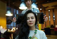 Zaozao Jiang having her hair set at a high grade hair salon in Beijing, China. 12-Jan-2013.  Jiang is a client of Sara Jane Ho who runs an etiquette school in Beijing, China.<br /> <br /> Please credit: Lou Lin Wei / Sinopix