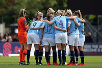 Manchester City women huddle before the start of the second half during Arsenal Women vs Manchester City Women, FA Women's Super League Football at Meadow Park on 11th May 2019