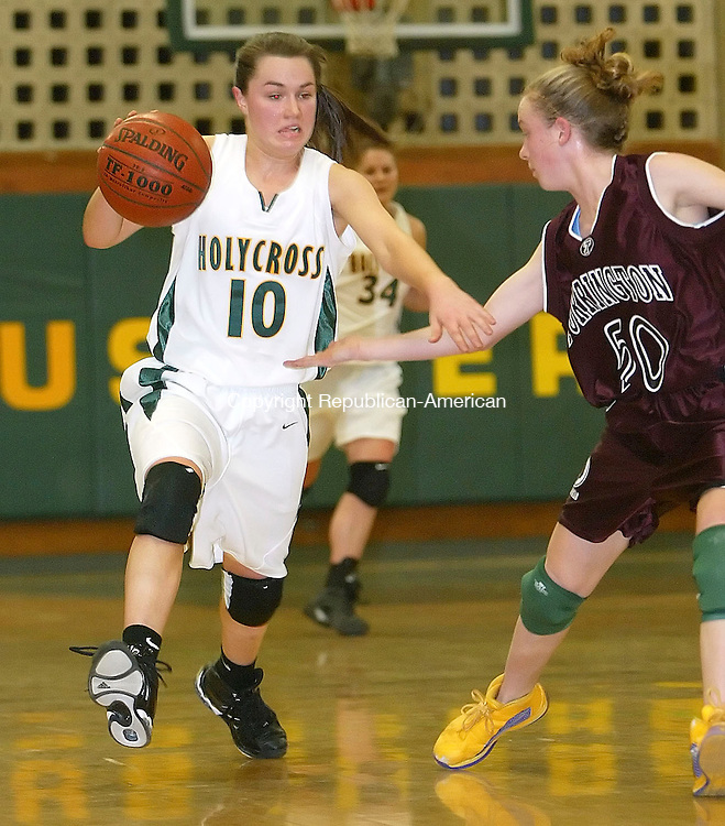 WATERBURY, CT, 02/09/07- 020907BZ14- Holy Cross's Kelly McKeon (10) drives past Torrington's Michelle Royals (50)<br /> during their game at Holy Cross Friday night.<br /> Jamison C. Bazinet Republican-American