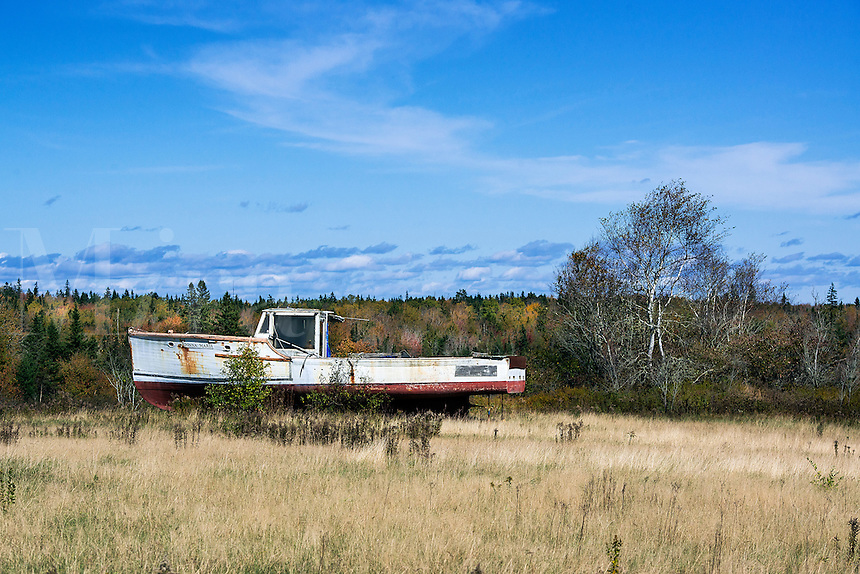 Abandoned lobster boat in a rural field, Maine, USA