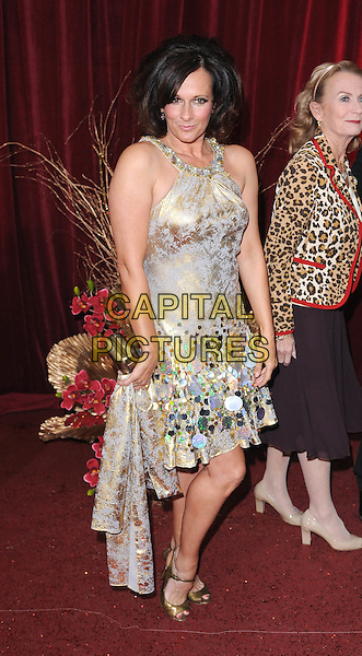 SIAN REEVES.Arrivals at the British Soap Awards 2010, London Television Centre, London, England..May 8th, 2010.full length gold silver shiny dress metallic paillettes shoes peep toe clutch ba.CAP/BEL.©Tom Belcher/Capital Pictures.