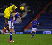 AFC Wimbledon's Adedeji Oshilaja (L) climbs above Oldham Athletic's Craig Davies (R) during the Sky Bet League 1 match between Oldham Athletic and AFC Wimbledon at Boundary Park, Oldham, England on 21 November 2017. Photo by Juel Miah/PRiME Media Images