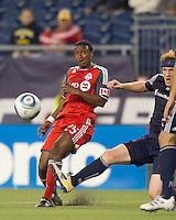 Toronto FC defender Danleigh Borman (25) chip pass as New England Revolution midfielder Pat Phelan (28) defends. In a Major League Soccer (MLS) match, the New England Revolution tied Toronto FC, 0-0, at Gillette Stadium on June 15, 2011.