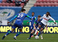 8th February 2020; DW Stadium, Wigan, Greater Manchester, Lancashire, England; English Championship Football, Wigan Athletic versus Preston North End; Daniel Johnson of Preston North End controls the ball under pressure from Michael Jacobs and Kieffer Moore of Wigan Athletic