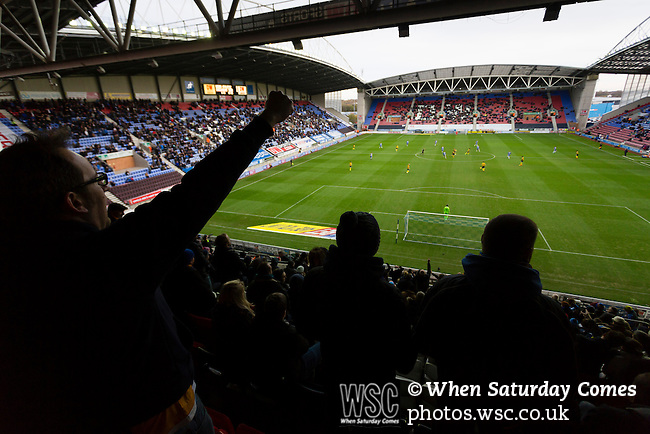 Wigan Athletic 1 Shrewsbury Town 0, 21/11/2015. DW Stadium, League One. The DW Stadium. Wigan Athletic earned a narrow 1-0 at home to Shrewsbury Town. Wigan competed in the Premier League from 2005 to 2013. They won the 2013 FA Cup. The club also embarked on its first European campaign during the 2013–14 UEFA Europa League. Shrewsbury fans cheering at kick off. Photo by Paul Thompson