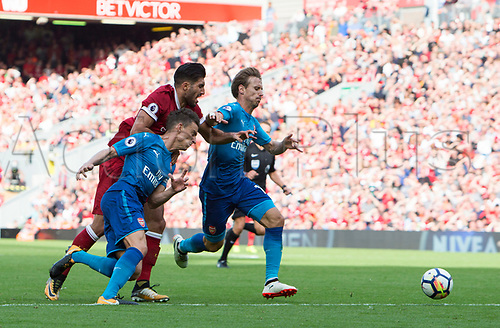 27th August 2017, Anfield, Liverpool, England; EPL Premier League football, Liverpool versus Arsenal; Emre Can of Liverpool is blocked by Laurent Koscielny and Rob Holding of Arsenal as he chases the ball into the penalty area