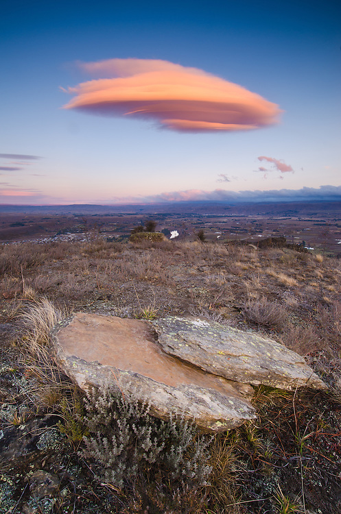Pink lenticular cloud  seen from Clyde lookout. Central Otago, South Island, New Zealand.