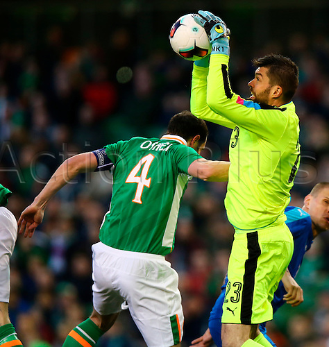 29.03.2016. Aviva Stadium, Dublin, Ireland. International Football Friendly Rep. of Ireland versus Slovakia. <br /> Matus Kozacik (Slovakia) claims the ball ahead of John O&rsquo;Shea (Captain Rep. of Ireland).