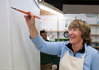 Female painting & decorating trainee,  Able Skills training centre, Dartford, Kent.