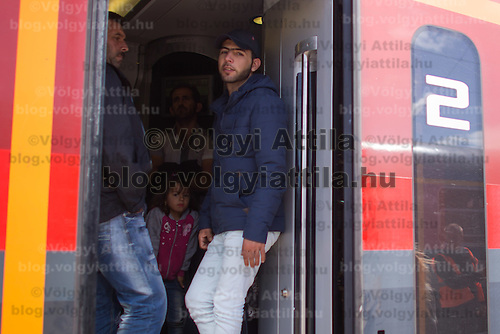 Illegal migrants traveling to Germany stand on a train headed for Munich near Hegyeshalom (about 180 km West of capital city Budapest), Hungary on September 06, 2015. ATTILA VOLGYI