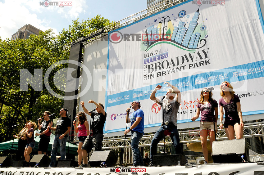 """NEW YORK - AUGUST 16: Cast of """"Rock of Ages"""" on stage during 106.7 Lite FM Presents Broadway in Bryant Park on August 16, 2012 in New York City. (Photo by MPI81/MediaPunchInc)"""