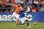 10 November 2007:  Scott Sealy (r) of the Kansas City Wizards battles for a loose ball against Ryan Cochrane (5) of the Houston Dynamo.  The MLS Houston Dynamo defeated the Kansas City Wizards 2-0 at Robertson Stadium, Houston, Texas to capture the 2007 MLS Western Conference title and to advance to the MLS Cup championship final on Saturday, November 18th.
