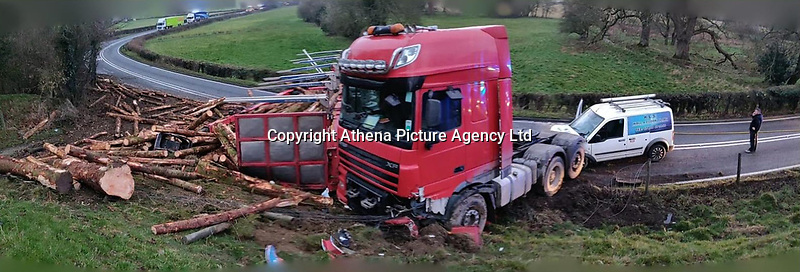 Pictured: The scene of the accident in which a lorry carrying timber overturned A470 is closed between Llandinam and Llanidloes in Powys, Wales, UK. Friday 01 March 2019<br /> Re: A lorry carrying timber has overturned and spilled its load on the A470 road which had to close between Llandinam and Llanidloes in Powys, mid Wales.<br /> A large amount of timber was spread across the road and verge, and work is continuing to turn the lorry upright.<br /> No one was hurt.<br /> An environmental unit, Mid and West Wales Fire and Rescue Service attended along with Dyfed-Powys Police.