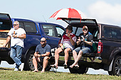 Karak supporters watch the game from the top of the embankment. Counties Manukau Premier Counties Power Club Rugby game between Karaka and Pukekohe, played at the Karaka Sports Park on Saturday March 10th 2018. Pukekohe won the game 31 - 27 after trailing 5 - 20 at halftime.<br /> Photo by Richard Spranger.
