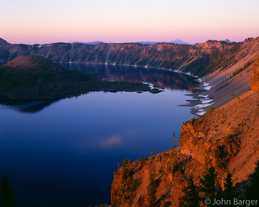 ORCL_035 - USA, Oregon, Crater Lake National Park, Sunrise light on Wizard Island, view south from Merriam Point with Mount Shasta and Mount McLoughlin visible in the distance.