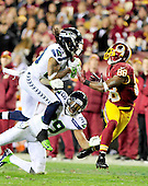 Seattle Seahawks free safety Earl Thomas (29) intercepts a pass intended for Washington Redskins wide receiver Pierre Garcon (88) in second quarter action of an NFC Wild-card play-off game at FedEx Field in Landover, Maryland on Sunday, January 6, 2013.  Seahawks cornerback Brandon Browner (39) is also defending on the play. The Seahawks won the game 24 - 14..Credit: Ron Sachs / CNP