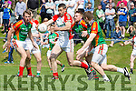 Shane McSweeney Kilcummin gets ready to shoot under pressure from Damien O'Leary and Peter Crowley  Mid Kerry during the SFC in Killorglin on Sunday
