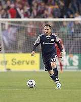 New England Revolution defender Ryan Cochrane (45) brings the ball forward. In a Major League Soccer (MLS) match, the New England Revolution tied the Colorado Rapids, 0-0, at Gillette Stadium on May 7, 2011.