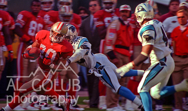San Francisco 49ers vs. Carolina Panthers at Candlestick Park Sunday, November 5, 1995.  Panthers beat 49ers  13-7.  Carolina Panthers defensive back Tyrone Poole (38) pursues San Francisco 49ers running back Derek Loville (20).