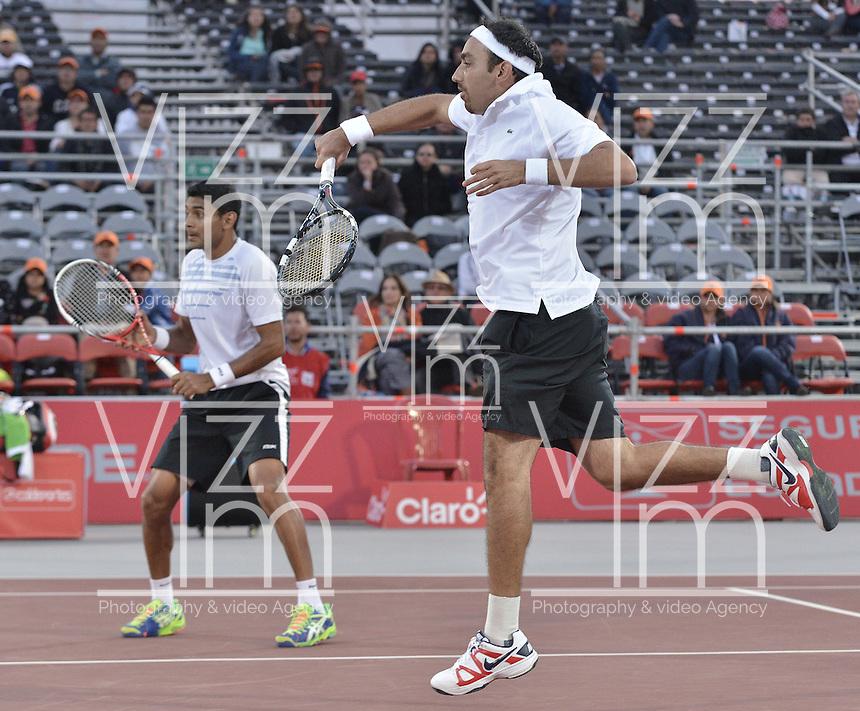 BOGOTÁ -COLOMBIA. 20-07-2013. Purav Raja (IND)(I)/ Dijiv Sharan (IND)(D) durante el juego contra Edouard Roger-Vasselin (FRA)/Igor Sijsling (HOL) en dobles en final del ATP Claro Open Colombia 2013 realizado hoy en el Centro de Alto Rendimiento en la ciudad de Bogotá. La pareja de indues ganaron en el torneo ATP tour 250 en la categoría de dobles. / Purav Raja (IND)(L)/ Dijiv Sharan (IND)(R)   during match against Edouard Roger-Vasselin (FRA)/Igor Sijsling (HOL) on the final of the ATP Claro 2013 today at Centro Alto Rendimiento in Bogota city. The  hindu couple won the first place on the ATP tour 250 in doubles category. Photo: VizzorImage / Str