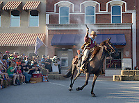 NWA Democrat-Gazette/BEN GOFF @NWABENGOFF<br /> Ron 'Horseshoe' Hodge of Springdale acts as one of the bank robbers on Friday Sept. 4, 2015 during a re-enactment of an 1893 bank robbery during First Friday September: Sugar Creek Days on the Bentonville square. The re-enactment was based on the June 5, 1893 robbery in which outlaw Henry Starr and five men made off with cash from the People's Bank of Bentonville after a shootout with civilians and the sheriff.