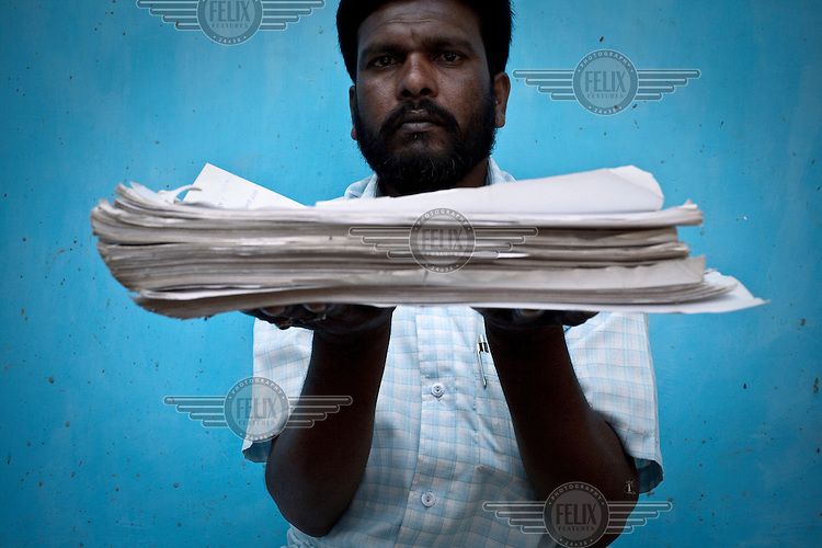 Leading the farmers' protest, 37 year old Kamal Kumar Ghabya fights for farmers' rights against forced land acquisition. He shows the papers supporting his struggle that he acquired from the government through the Rights to Information Act.