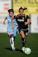 Manya Makoski (22) of the Los Angeles Sol is chased by Sarah Walsh (8) of Sky Blue FC. The Los Angeles Sol defeated Sky Blue FC 2-0 during a Women's Professional Soccer match at TD Bank Ballpark in Bridgewater, NJ, on April 5, 2009. Photo by Howard C. Smith/isiphotos.com