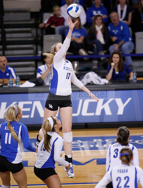 Lauren O' Connor of the UK Women's Volleyball team spikes the ball against Arkansas on 11/20/11 in Lexington, Ky. Photo by Quianna Lige | Staff