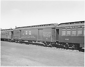 RPO &amp; baggage #54 car in railroad at Alamosa.  Coaches #312 and #284.<br /> D&amp;RGW  Alamosa, CO  1939