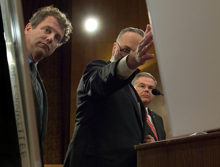 Sherrod Brown, D-Ohio, Joint Economic Committee Chairman Charles Schumer, D-N.Y. and Robert Menendez, D-N.J. during a news conference to release a new Joint Economic Committee report on the economic impact of the subprime mortgage crisis..