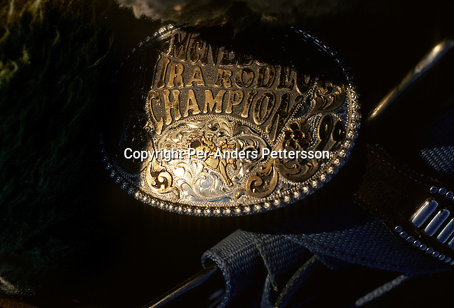An unidentified rodeo contestant's shows his championship belt before a rodeo on July 13, 1998 in Brownsville, Texas, USA. He attended a yearly rodeo held at a local stadium. Rodeo is on of the most popular pastimes in this area. (Photo by: Per-Anders Pettersson).