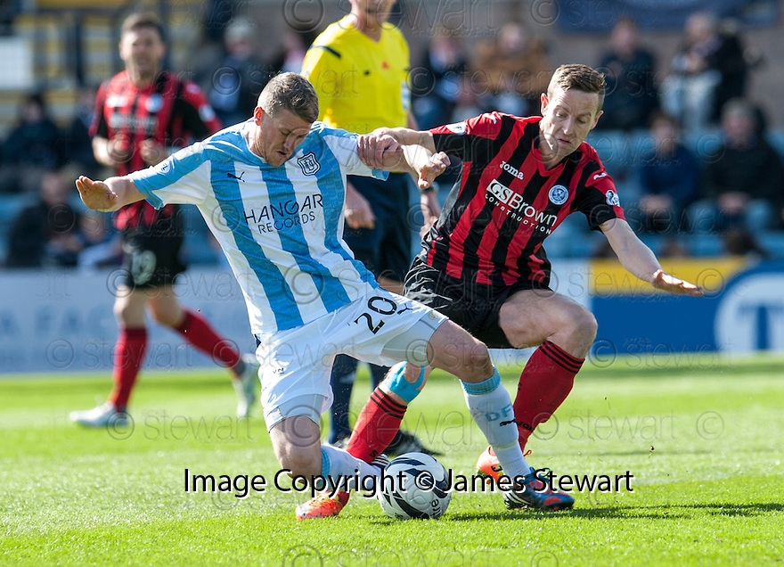 Dundee's Jim McAlister and St Johnstone's Steven MacLean challenge for the ball.