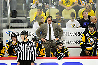 May 29, 2017: Pittsburgh Penguins head coach Mike Sullivan watches game action on the ice during game one of the National Hockey League Stanley Cup Finals between the Nashville Predators  and the Pittsburgh Penguins, held at PPG Paints Arena, in Pittsburgh, PA. Pittsburgh defeats Nashville 5-3 in regulation time.  Eric Canha/CSM