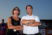 Aug. 30, 2013; Clermont, IN, USA: NHRA super comp driver Billy Torrence (right) with wife Kay Torrence during qualifying for the US Nationals at Lucas Oil Raceway. Mandatory Credit: Mark J. Rebilas-