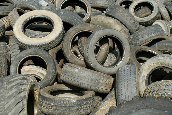A pile of used tyres at a garage in Asturias, Spain. 2008.