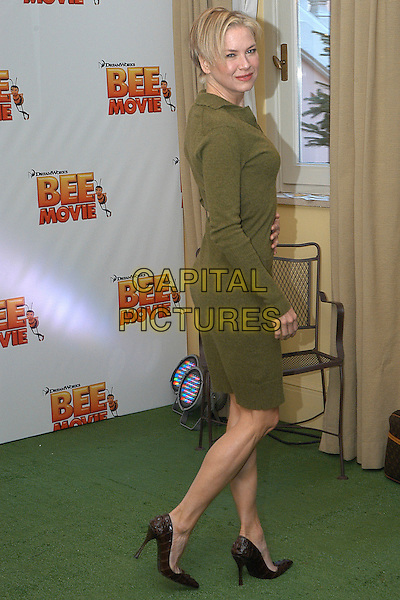 "RENEE ZELLWEGER.Photocall for ""Bee Movie"", Rome, Italy..December 4th, 2007.full length green sweater dress brown snakeskin shoes .CAP/CAV.©Luca Cavallari/Capital Pictures."