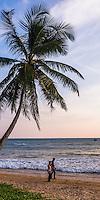 Tourists on tropical Mirissa Beach, South Coast of Sri Lanka, Asia. This is a photo of tourists on tropical Mirissa Beach, Sri Lanka, Asia. Mirissa Beach is a popular tropical beach on the South Coast of Sri Lanka.