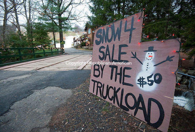 WOODBURY, CT--- -122615JS06--A sign in front of the Woodbury Ski Area in Woodbury offers &quot;snow for sale&quot; . According to general manager Scott D'Amato, they have sold a few truckloads for people who wanted to build snowmen for the holiday season. <br /> Jim Shannon Republican-American