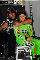 Danica Patrick (#10) spends time with a Stewart-Haas crewmember in the garage.