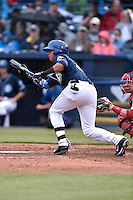 Asheville Tourists designated hitter Jonathan Daza (2) squares to bunt during game one of a double header against the Greenville Drive on April 18, 2015 in Asheville, North Carolina. The Tourists defeated the Drive 2-1. (Tony Farlow/Four Seam Images)