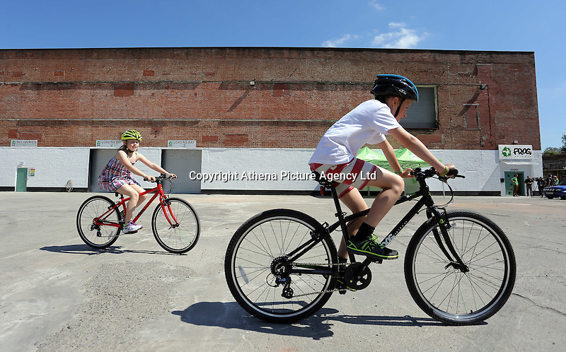 Pictured: Emily and Oscar Lawson, the children of the owners, test bikes Monday 15 August 2016<br />