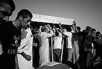 Casket is brought for burial during funeral ceremony in Zintan, Libya