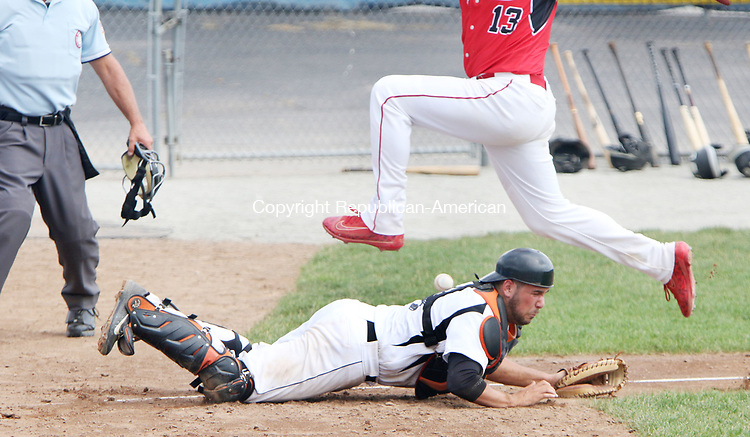TORRINGTON CT. 04 Augusr 2017-080417SV03-#13 Steven Nappe of North Haledon Reds jumps over #4 Matt Calzone of Watertown Blaze who misses the off target throw at the plate in the 4th inning during the Stan Musial tournament in Torrington Friday.<br /> Steven Valenti Republican-American