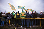 Away supporters cheering on their team during the first-half of the Boxing Day derby match between Runcorn Town and visitors Runcorn Linnets at the Pavilions, Runcorn, in a top-of the table North West Counties League premier division match. Runcorn Linnets won 1-0 and overtook their neighbours at the top of the league in a game watched by 803 spectators. Runcorn Linnets were a successor club to Runcorn FC, one of England foremost non-League clubs of the 1970s and 1980s.