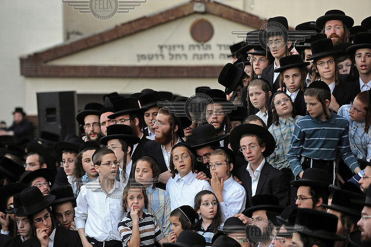 Ultra-orthodox Jewish children and young men take part in a burial ceremony for Torah scrolls that were destroyed in a fire. Eleven Torah scrolls were burnt in a fire that broke out in a synagogue during the Jewish holiday of Sukkot, following a short circuit in the Holy Ark.