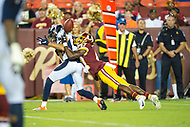 Landover, MD - August 24, 2018: Washington Redskins cornerback Prince Charles Iworah (47) forces a fumble late in the fourth quarter of preseason game between the Denver Broncos and Washington Redskins at FedEx Field in Landover, MD. The Broncos defeat the Redskins 29-17. (Photo by Phillip Peters/Media Images International)