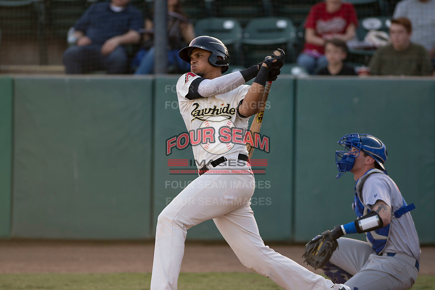 Visalia Rawhide left fielder Ramon Hernandez (16) follows through on his swing during a California League game against the Stockton Ports at Visalia Recreation Ballpark on May 8, 2018 in Visalia, California. Stockton defeated Visalia 6-2. (Zachary Lucy/Four Seam Images)