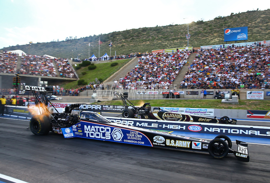 Jul. 19, 2013; Morrison, CO, USA: NHRA top fuel dragster driver Antron Brown (near lane) races alongside Khalid Albalooshi during qualifying for the Mile High Nationals at Bandimere Speedway. Mandatory Credit: Mark J. Rebilas-